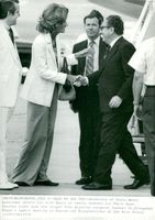 Henry Kissinger is welcomed by his wife Nancy on arrival at Andrews Air Force Base