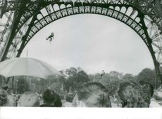 Men bungee jumping at the Eiffel Tower - May 1964