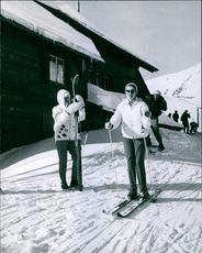 Princess Birgitta skiing in a snowy field and smiling.