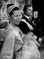 King Carl Gustaf together with Queen Silvia who has Prince Carl Philip in his father's baptism