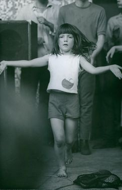 A child standing barefooted. October 7, 1967