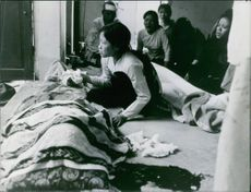 Families and relatives of the dead bodies are grieving and crying during the war in Vietnam, 1966.