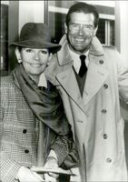 """Roger Moore with his wife at the premiere of the musical """"Aspects of Love"""""""
