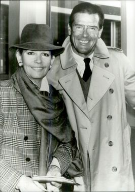 "Roger Moore with his wife at the premiere of the musical ""Aspects of Love"""