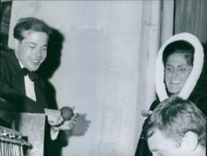 Prince Michel with his wife Béatrice, having fun together.