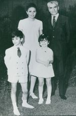Family photo of King Mohammad Reza Shah Pahlavi of Iran with his wife Farah and children Reza and Farahnaz.  Taken - 5 July 1968