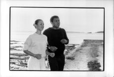 Muhammad Ali jogging with his wife Veronica on a beach near Nassau in the Bahamas.