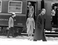 Royal family in the train - Prince Philip Duke of Edinburgh with his children Princess Anne and Prince Charles getting off the train