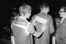 Man having Kennedy's name on his back.