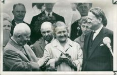 Mr. Khruschev and his wife with Mr. Krag.