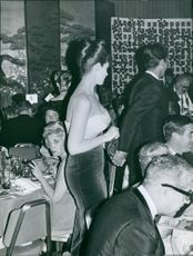 Tina Louise in restaurant with man together with Mac Kim and Kim Novak. Photo taken on October 26, 1961.