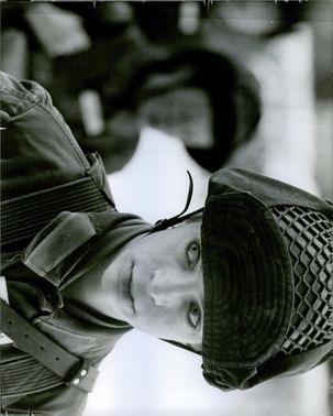 Close up photo of a soldier.