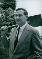 Leonard James Callaghan photographed holding spade. 1963.