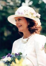 Portrait picture of Queen Silvia in one of her many dressy hats. The picture was taken during a state visit in Finland.