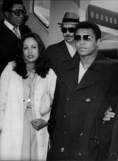 Muhammad Ali and his wife Veronica at Heathrow Airport. They are on their way to Bangladesh.