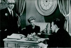 "Actress Signe Hasso and Leo G. Carroll in the movie ""The House on 92nd Street"""