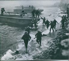 Soldiers running together during wartime.