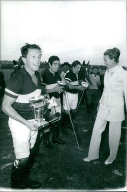 Princess Maria Gabriella on race course, giving up the winning trophies.