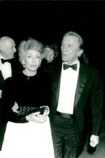 """Kirk Douglas along with his wife Anne arrives at an """"All Star Party"""" for Frank Sinatra in Los Angeles"""