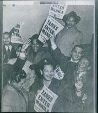 Filipinos in New York waving placards that notify the Manila Liberation 1945