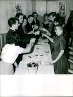 Prince Michael of Kent having a toast while dining at a party.