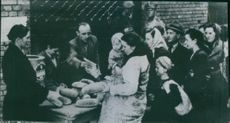 Russians distribute bread in liberated suburb of Warsaw. 1945