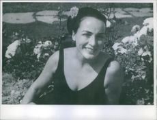 Astrid Blesvik smiling while in the garden.