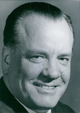 Close-up photo of Paul Lucke smiling.