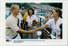 Crown Princess Victoria welcomes Swedish silver medalist in archery Magnus Petersson while Queen Silvia looks at