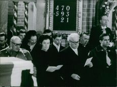 People reading cards at the funeral of Louise Mountbatten.
