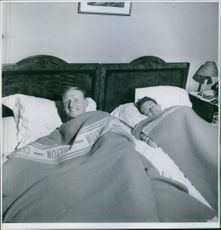 Two man lying on bed, 1939.