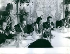 Ferhat Abbas is having a conference over lunch. 1964
