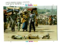 rwanda war. a queue of refugees.