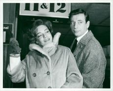 Simone Signoret and Yves Montand at London Airport