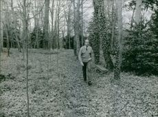 Giscard walking in the forest.
