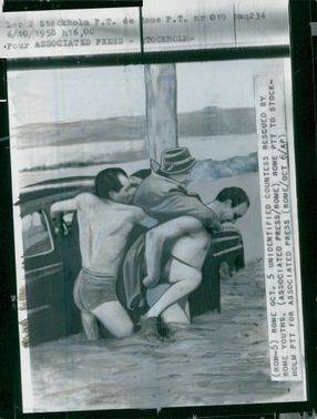 Hovfröken Brita Steuch is carried from the flooded car in Rome
