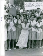 Protesters raising their banners during a demonstration in Bizerte. 1961.