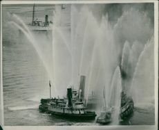 Three waterfront fire protection boats forming a triangle and demonstration.