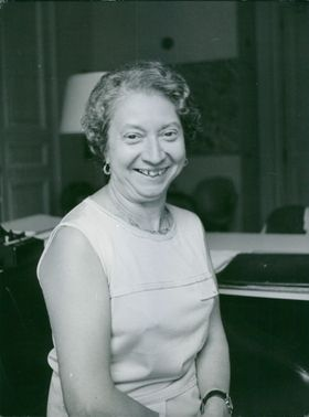 Woman smiling while looking at the camera.