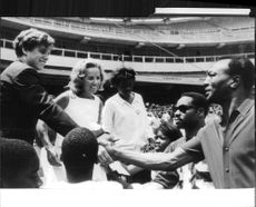 """Robert Francis """"Bobby"""" Kennedy`s wife looking at man from the crowd."""