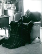 António de Oliveira Salazar sitting on a sofa, resting.