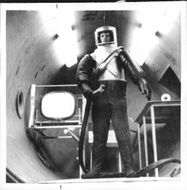 An American scientist explore how the human body reacts in space by an experiment in an evacuated pressure chamber.