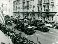 Trucks with missiles parading on the street, with people on the side watching, April 1972.