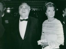 Harry Saltzman with woman at a party. 1969.