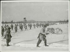 The Swedish Volunteer Corps marching on the snowy ground in Finland. 1940