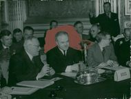 Molotov discusses, less bister than usual, any negotiation points with Vysjinski at the Parish meeting