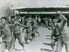 Vice President Hubert Humphrey witnessing a martial arts demonstration performed by Korean troops stationed in Vietnam.
