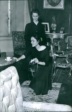 Princess Margarita with another woman sitting together and communicating with her.