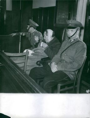 Two policeman sitting with an injured man.