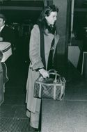 Florinda Bolkan seen smiling while holding her bag at the airport. 1972.